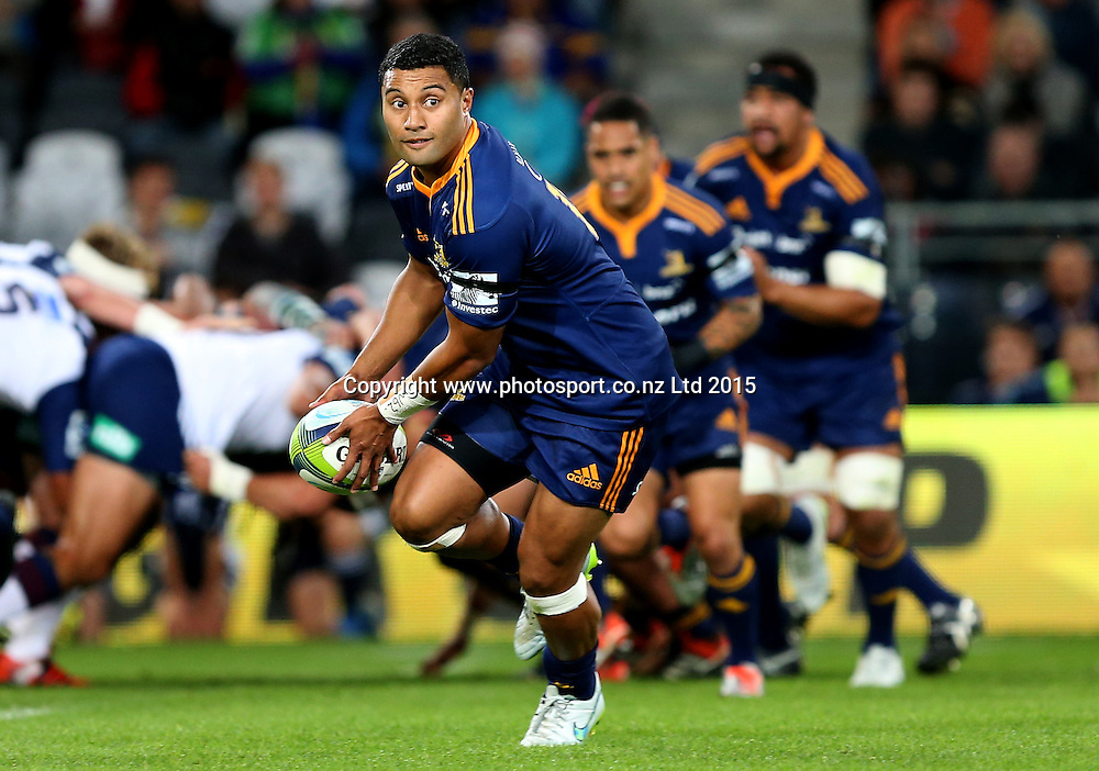 Highlanders Lima Sopoaga  looks to pass the ball during the Super 15 rugby match between the Highlanders and the Blues at Forsyth Barr Stadium, Dunedin, Saturday, April 18, 2015. Photo: Dianne Manson / www.photosport.co.nz
