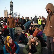 Thousands of Extinction Rebellion activists took over 5 bridges in Central London and blocked them for the day, November 17 2018, Central London, United Kingdom. Lambeth Bridge; Roger Hallam from Extinction Rebellion talks to some of the activists prepared to be arrested. Around 11am people on all bridges sat down in the road and blocked traffic from coming through and stayed till late afternoon. The actvists believe that the government is not doing enough to avoid catastrophic climate change and they demand the government take radical action to save future generations and the planet. Many are willing to be arrested peacefully protesting and up to 80 were arrested on the day. Extinction Rebellion is a grass root climate change group started in 2018 and has gained a huge following of people commited to peaceful protests and who ready to be arrested. Their major concern is that the world is facing catastropohic climate change and they want the British government to act now to save future generations.