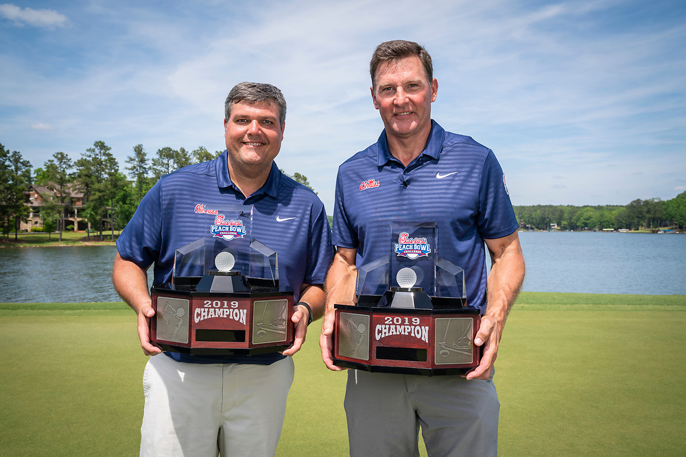 Ole Miss head football coach Matt Luke and Former Ole Miss tight end Wesley Walls pose for a photo after winning 2019 Chick-fil-A Peach Bowl Challenge trophy at the Ritz Carlton Reynolds, Lake Oconee, on Tuesday, April 30, 2019, in Greensboro, GA. (Paul Abell via Abell Images for Chick-fil-A Peach Bowl Challenge)