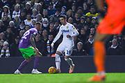 Pablo Hernandez of Leeds United (19) takes on Jack Hunt of Bristol City (32) during the EFL Sky Bet Championship match between Leeds United and Bristol City at Elland Road, Leeds, England on 24 November 2018.