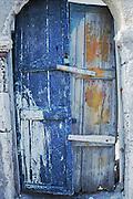 Oia, Santorini Island, Greece: rickety blue wood door, locked