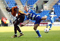 Photo. Chris Ratcliffe<br /> Reading v Wolverhampton Wanderers. Coca Cola Championship. 30/04/2005<br /> Steve Sidwell of Reading challenges Seyi Olofinjana of Wolves