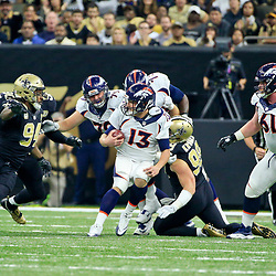 Nov 13, 2016; New Orleans, LA, USA;  New Orleans Saints defensive end Paul Kruger (99) sacks Denver Broncos quarterback Trevor Siemian (13) during the first half of a game at the Mercedes-Benz Superdome. Mandatory Credit: Derick E. Hingle-USA TODAY Sports