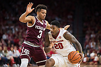 FAYETTEVILLE, AR - FEBRUARY 17:  Darious Hall #20 of the Arkansas Razorbacks drives against Admon Gilder #3 of the Texas A&M Aggies at Bud Walton Arena on February 17, 2018 in Fayetteville, Arkansas.  The Razorbacks defeated the Aggies 94-75.(Photo by Wesley Hitt/Getty Images) *** Local Caption *** Darious Hall; Admon Gilder