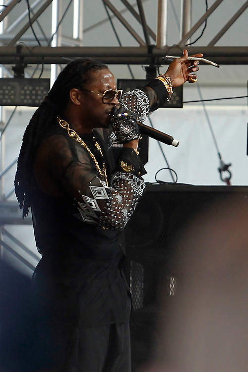 2 Chainz performs on 420 with a giant joint in his hand at the Coachella Music Festival in Indio Calif., on Saturday, April 20, 2013. Making a special guest appearance during the set was members of Fall Out Boy: Pete Wentz and Patrick Stump.