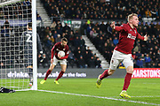 Northampton Town midfielder Nicky Adams scores and celebrates during the The FA Cup match between Derby County and Northampton Town at the Pride Park, Derby, England on 4 February 2020.