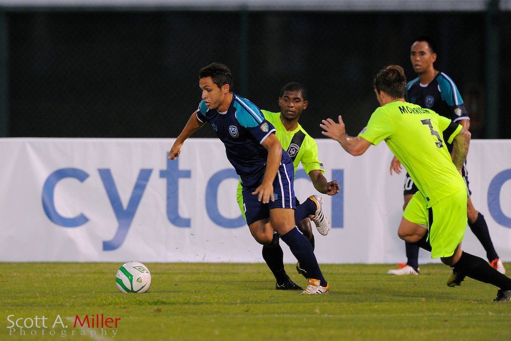VSI Tampa Bay FC midfielder Douglas Goncalves dos Santos (7) in action against the Phoenix FC Wolves in a USL Pro soccer match at Plant City stadium in Plant City, Florida on June 9, 2013.<br /> <br /> &copy;2013 Scott A. Miller