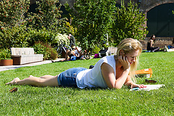 © Licensed to London News Pictures. 23/08/2019. London, UK. Beck reads a book while while lying on the grass on a warm and sunny day in London. According to the Met Office, the temperatures are forecast to increase to 30 degrees celsius for the bank holiday weekend.  <br /> <br /> ***Permission Granted*** <br /> <br /> Photo credit: Dinendra Haria/LNP