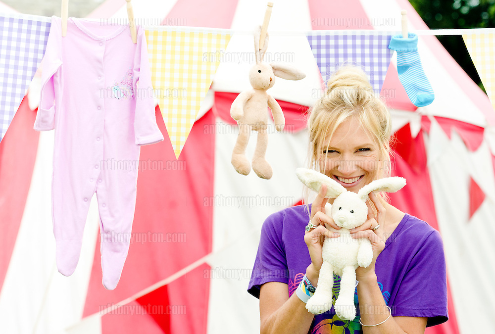 20110730                 Copyright image 2011©.READY, TEDDY, GO!.DJ and mum-of-four Jo Whiley hosted the first 'Persil Pass on the Love Picnic' at Camp Bestival this weekend. Mums and kids were encouraged to hold a picnic and bring newly washed soft toys for another child to love - for fun family picnic ideas and more visit www.netmums.com/persilpassonthelove.oThe traditional teddy bears picnic is set for a refresh this year thanks to Jo Whiley and Persil 2in1 with Comfort.oWe all know that kids quickly grow out of their teddies, so rather than throw them away, Jo is encouraging mums to bring their old (but clean!) soft toys and then pass them on for another child to love - either by swapping with a friend or donating them to charity partner Oxfam who will sell them on.oHold your very own picnic by getting fun tips, advice and activity sheets at www.netmums.com/persilpassonthelove.For more details please contact:.jwalsh@golinharris.com /  020 7067 0416.alaxton@golinharris.com / 020 7067 0614.Mandatory Credit Ant Upton otherwise additional charges will apply..For photographic enquiries please call Anthony Upton  + 447973 830 517 or email info@anthonyupton.com .This image is copyright Anthony Upton 2011© and must be credited Anthony Upton. The author is asserting his full Moral rights in relation to the publication of this image. All rights reserved. Rights for onward transmission of any image or file is not granted or implied. Changing or deleting Copyright information is illegal as specified in the COPYRIGHT, DESIGN AND PATENTS ACT 1988. If you are in any way unsure of your right to publish this image please contact Anthony Upton on +44 7973 830 517 or email: info@anthonyupton.com