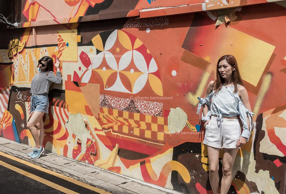 Singapore, posing in Arab Street