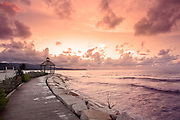 A boardwalk at sunset along the Montego Bay coast in Jamaica leading to a gazebo