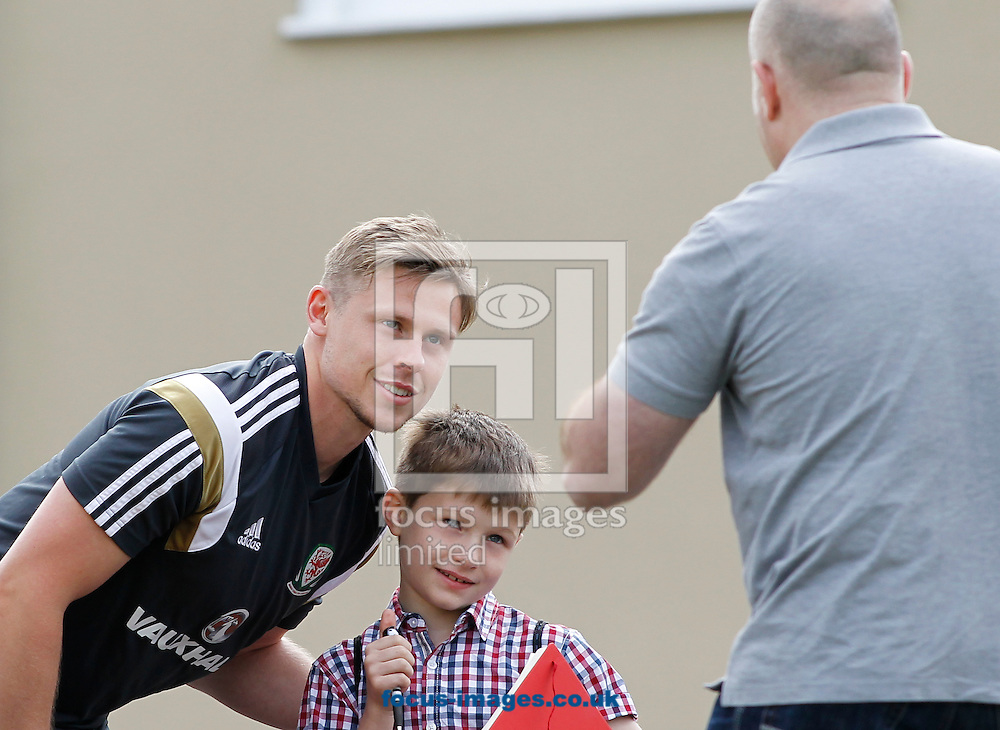 Chris Gunter poses with a fan before the Wales Training session at the Vale Resort, Hensol<br /> Picture by Mike Griffiths/Focus Images Ltd +44 7766 223933<br /> 08/06/2015