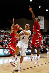 Nov 14, 2011; Stanford CA, USA;  Stanford Cardinal guard Aaron Bright (2) shoots past Fresno State Bulldogs guard Tyler Johnson (1) during the first half of a preseason NIT game at Maples Pavilion. Mandatory Credit: Jason O. Watson-US PRESSWIRE