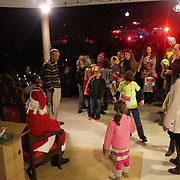 Children line up to see Santa Claus during the Greenfield Christmas Tree lighting at Greenfield Lake Park Thursday December 4, 2014 in Wilmington, N.C. (Jason A. Frizzelle)