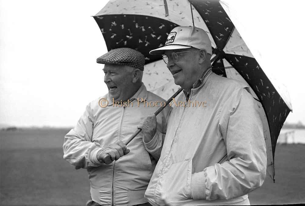 General Dwight D. Eisenhower plays golf in the rain with Joe Carr, the Irish Walker Cup Player, Mr. M. McCluskey, the United States Ambassador to Ireland, and Mr. Freeman Godsen, a member of the Generals Party, at Portmarnock Golf Club..23.08.1962.<br />