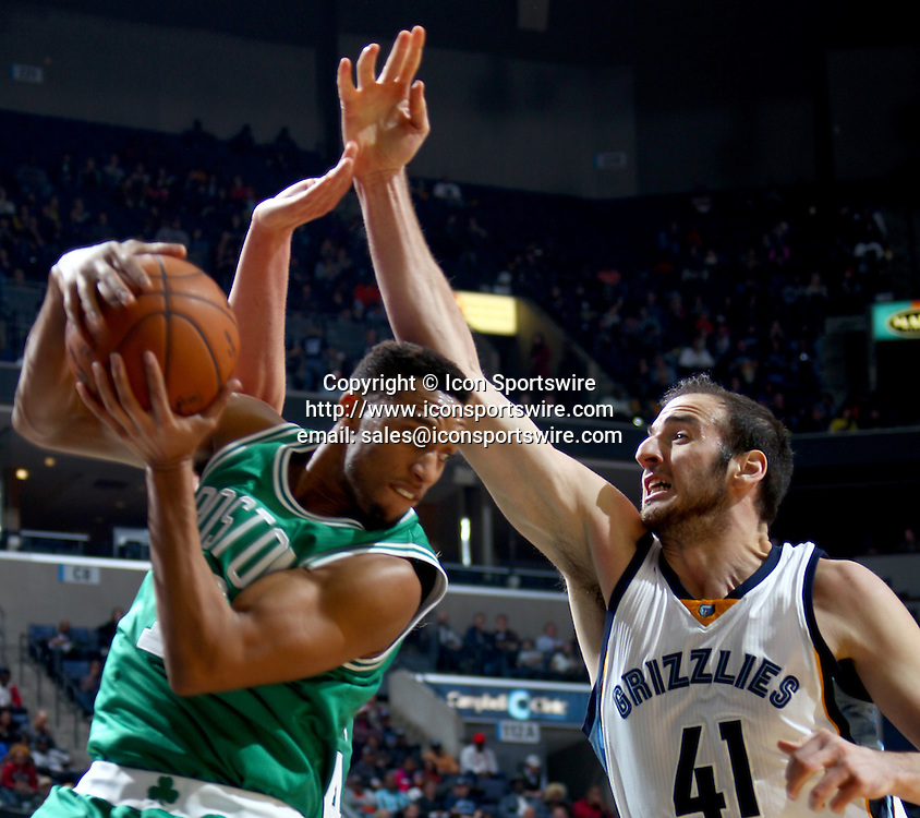 Nov. 21, 2014 - Memphis, TN, USA - The Boston Celtics' Evan Turner, left, grabs a rebound from the Memphis Grizzlies' Kosta Koufos (41) at FedExForum in Memphis, Tenn., on Friday, Nov. 21, 2014. The Grizzlies won, 117-100.