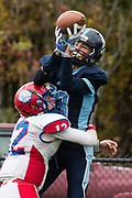 MMU's Jakobe Putzer (88) leaps to catch the ball over Hartford's Tyler Hamilton (12) during the high school football game between the Hartford Hurricanes and the Mount Mansfield Cougars at MMU High School on Saturday afternoon October 14, 2017 in Jericho. (BRIAN JENKINS/for the FREE PRESS)