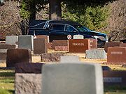 22 NOVEMBER 2019 - DES MOINES, IOWA: The hearse carrying the remains of Marine Corps Reserve Private Channing Whitaker arrives in Glendale Cemetery. Whitaker died in the Battle of Tarawa on Nov. 22, 1943 during World War Two. He was buried on Betio Island, in the Gilbert Islands, and his remains were recovered in March 2019. He was identified by a DNA match with surviving family members in Iowa. Whitaker was reintered in the Glendale Cemetery in Des Moines exactly 76 years after his death in World War Two. About 1,000 US Marines and sailers were killed in four days during the Battle of Tarawa.           PHOTO BY JACK KURTZ