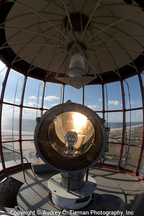 Babylon, NY,  October 25, 2016: ---  The fresnel lens in the tower of the Fire Island Lighthouse with sweeping views looking west..     © Audrey C. Tiernan