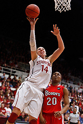 March 21, 2011; Stanford, CA, USA; Stanford Cardinal forward Kayla Pedersen (14) shoots past St. John's Red Storm guard Keylantra Langley (20) during the second half of the second round of the 2011 NCAA women's basketball tournament at Maples Pavilion. Stanford defeated St. John's 75-49.