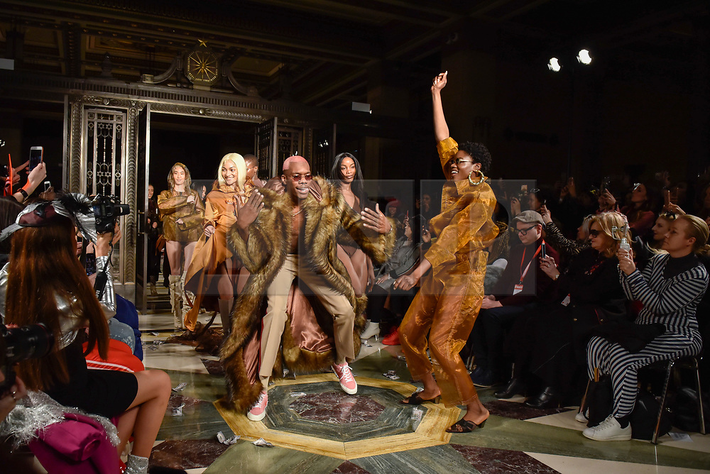 © Licensed to London News Pictures. 16/02/2018. LONDON, UK. Models present looks by Fortie Label at Fashion Scout AW18, part of London Fashion Week, taking place at Freemasons Hall in Covent Garden.  Photo credit: Stephen Chung/LNP