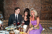 REG TRAVIS; AMY WINEHOUSE; KIRSTY SHAW-RAYNER, Opening of London's largest South african restaurant: Shaka Zulu. Stables amrket. Camden. London. 4 August 2010. <br /> -DO NOT ARCHIVE-© Copyright Photograph by Dafydd Jones. 248 Clapham Rd. London SW9 0PZ. Tel 0207 820 0771. www.dafjones.com.