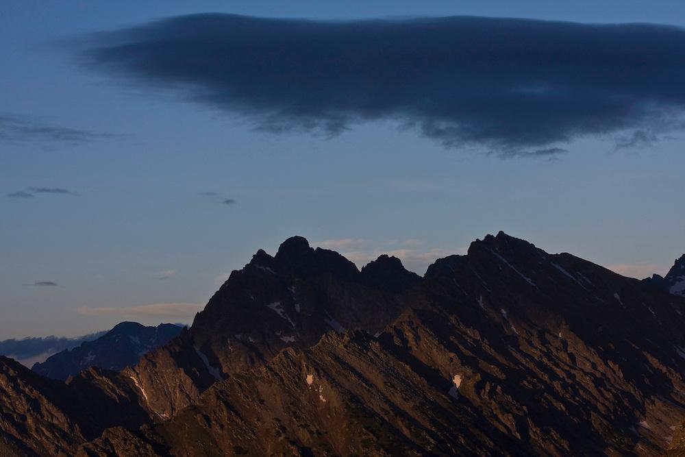 Dark cloud above mount Koprovsky stit (2363m asl) and Mengusovsky stit (2438m als) at sunset. High Tatras, Slovakia. June 2009. Mission: Ticha