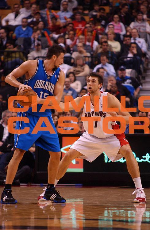 DESCRIZIONE : Toronto Campionato NBA 2007-2008 Toronto Raptors Orlando Magic<br /> GIOCATORE : Andrea Bargnani Hedo Turkoglu <br /> SQUADRA : Toronto Raptors Orlando Magic<br /> EVENTO : Campionato NBA 2007-2008 <br /> GARA : Toronto Raptors Orlando Magic<br /> DATA : 07/11/2007 <br /> CATEGORIA : <br /> SPORT : Pallacanestro <br /> AUTORE : Agenzia Ciamillo-Castoria/V.Keslassy<br /> Galleria : NBA 2007-2008 <br /> Fotonotizia : Toronto Campionato NBA 2007-2008 Toronto Raptors Orlando Magic<br /> Predefinita :