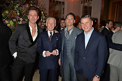 Left to right, THOMAS STUBBS, EDWARD SEXTON, GUY HILLS and JEREMY HACKETT at a reception hosted by The Rake Magazine and Claridge's to celebrate London Collections 2015 held at Claridge's, Brook Street, London on 8th January 2015.