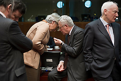 Christine Lagarde, France's finance minister, center left, and Giulio Tremonti, Italy's finance minister, center right, try to have a private conversation during the emergency meeting of European Union finance ministers in Brussels, Belgium, on Sunday, May 9, 2010.  European Union finance ministers meet today to hammer out the details of an emergency fund to prevent a sovereign debt crisis from shattering confidence in the 11-year-old euro. (Photo © Jock Fistick)