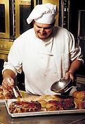 Chef preparing bread.