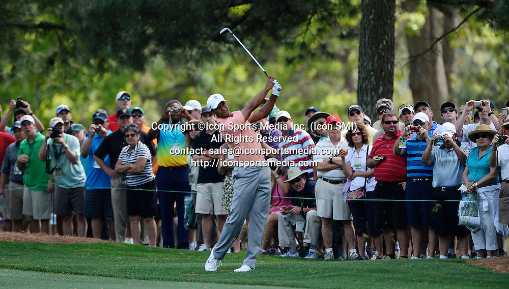 April 9, 2013 - Augusta, Georgia, U.S. - Tiger Woods hits his second shot on #1, Tuesday, April 9, 2013, in Augusta, Ga.