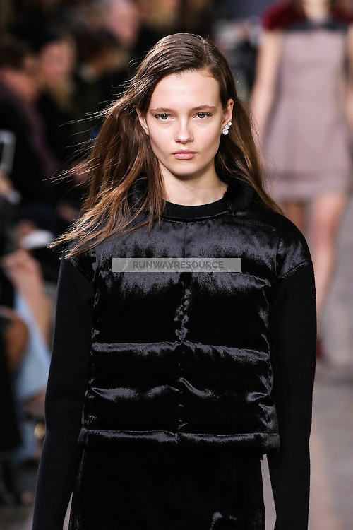 Alicja Tubilewicz walks the runway wearing Jason Wu Fall 2016, Hair by Paul Hanlon for Morocconoil, Makeup by Yadim for Maybelline, shot by Thomas Concordia during New York Fashion Week on February 12, 2016