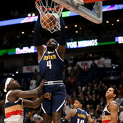 Jan 30, 2019; New Orleans, LA, USA; Denver Nuggets forward Paul Millsap (4) dunks over New Orleans Pelicans guard Jrue Holiday (11) and guard Frank Jackson (15) during the first quarter at the Smoothie King Center. Mandatory Credit: Derick E. Hingle-USA TODAY Sports