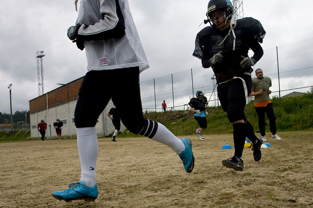 (Santiago de Compostela, Spain - May 1, 2010) -The Galicia Black Towers practice on their dirt field on Saturday morning outside Santiago de Compostela. The team prepares for their first round playoff match up in a few weeks. ..Photo by Will Nunnally / Will Nunnally Photography