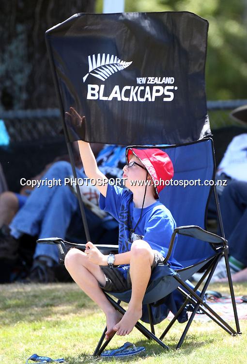 A young cricket fan looks on during play on Day 3 of the 1st test match.  New Zealand Black Caps v Pakistan, Test Match Cricket. Seddon Park, Hamilton, New Zealand. Sunday 9 January 2011. Photo: Andrew Cornaga/photosport.co.nz