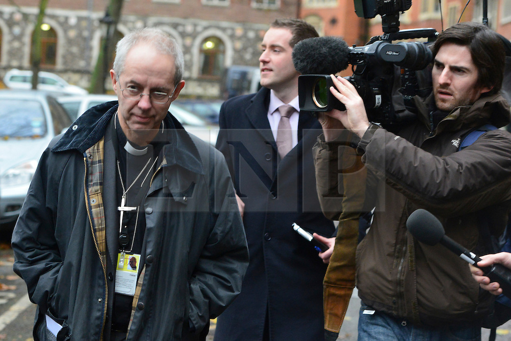 © Licensed to London News Pictures. 21/11/2012. westminster, UK Dr Justin Welby, The new Arch Bishop of Canterbury in waiting leaving Church House in Westminster after the Emergency meeting of House of Bishops. London for day three of the three-day Church of England General Synod. Members last night voted against ordaining women as priests.. Photo credit : Stephen Simpson/LNP