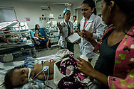 "BARQUISIMETO, VENEZUELA - AUGUST 29, 2017: Doctors explain they don't have the tests they need, to Albiannys Castillo who rushed her 5-month old daughter Dayferlin Aguilar to the emergency room of Dr. Agustín Zubillaga University Hospital of Pediatrics on August 28th, when Dayferlin became very weak, falling in and out of consciousness and had uncontrollable diahrrea. Doctors diagnosed her with malnutrition and dehydration. Ms. Castillo told doctors that she is physically unable to produce breast milk, and in desperation from not being able to find infant formula to feed her daughter, she had spent the last week feeding her bottles of whole milk that came with the government food ration box. Dayferlin was born healthy, on March 19, 2017 weighing 7 pounds 11 ounces, however because of the lack of infant formula, she only gained one pound, 8 ounces in the five months between when she was born and admitted into the hospital. In effort to buy her daughter formula, Ms. Castillo routinely arrived at 1am to wait in line until 10am outside of pharmacies, however more than not they would not have any in stock, or would run out of their limited supply by the time she got to the front of the line. Ms. Castillo did not sleep for days, keeping vigil next to Dayferlin's hospital bedside. Ms. Castillo never wanted her to open her eyes and feel alone. ""She opens them and will look at me before falling back to sleep, and I tell her, ""your mamá is here with you, my daughter - and I love you"". She said she knew feeding her whole milk was not good for her, but that it was impossible to find infant formula. ""I prefer to give her what I can find even if it is something I know will hurt her, than let her die of starvation,"" she said. Dayferlin died three days later, on August 31, 2017 from complications of malnutrition. If infant formula was available in Venezuela, doctors say it is unlikely she would have ever fallen ill. PHOTO: Meridith Kohut for The New York Times"