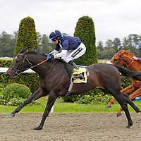 George Cinq and Hayley Turner winning the 2.50 race