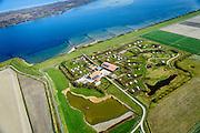 Nederland, Zeeland, Gemeente Schouwen-Duiveland, 01-04-2016; <br /> Landschapscamping Kijkuit aan de oevers van het Grevelingenmeer, het grootste zoutwatermeer van West-Europa.<br /> Caravan camping at border of Grevelingen (or Grevelingenmeer)<br /> the largest saltwater lake in Western Europe.<br /> <br /> luchtfoto (toeslag op standard tarieven);<br /> aerial photo (additional fee required);<br /> copyright foto/photo Siebe Swart