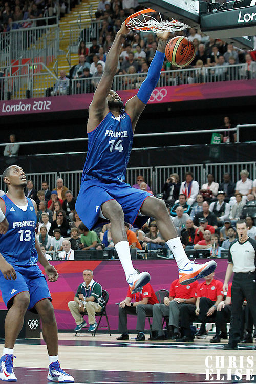 29 July 2012: Ronny Turiaf of France dunks the ball during the 98-71 Team USA victory over Team France, during the men's basketball preliminary, at the Basketball Arena, in London, Great Britain.