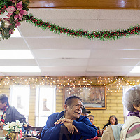 121814       Cable Hoover<br /> <br /> Andrew Jymm and other patrons of the Ford Canyon Senior Center watch Christmas performance by students of Churchrock Academy Thursday at the senior center.