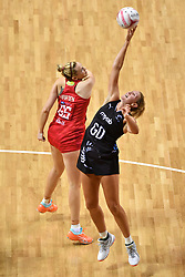 England Roses' Jo Harten and Silver Ferns' Casey Kopua compete for possession during the Vitality Netball International Series match at the Echo Arena, Liverpool.