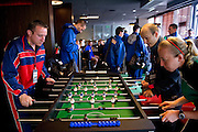 Referees and athletes play table-soccer during the 2013 Special Olympics European Unified Football Tournament in Warsaw, Poland.<br /> <br /> Poland, Warsaw, June 06, 2012<br /> <br /> Picture also available in RAW (NEF) or TIFF format on special request.<br /> <br /> For editorial use only. Any commercial or promotional use requires permission.<br /> <br /> <br /> Mandatory credit:<br /> Photo by &copy; Adam Nurkiewicz / Mediasport