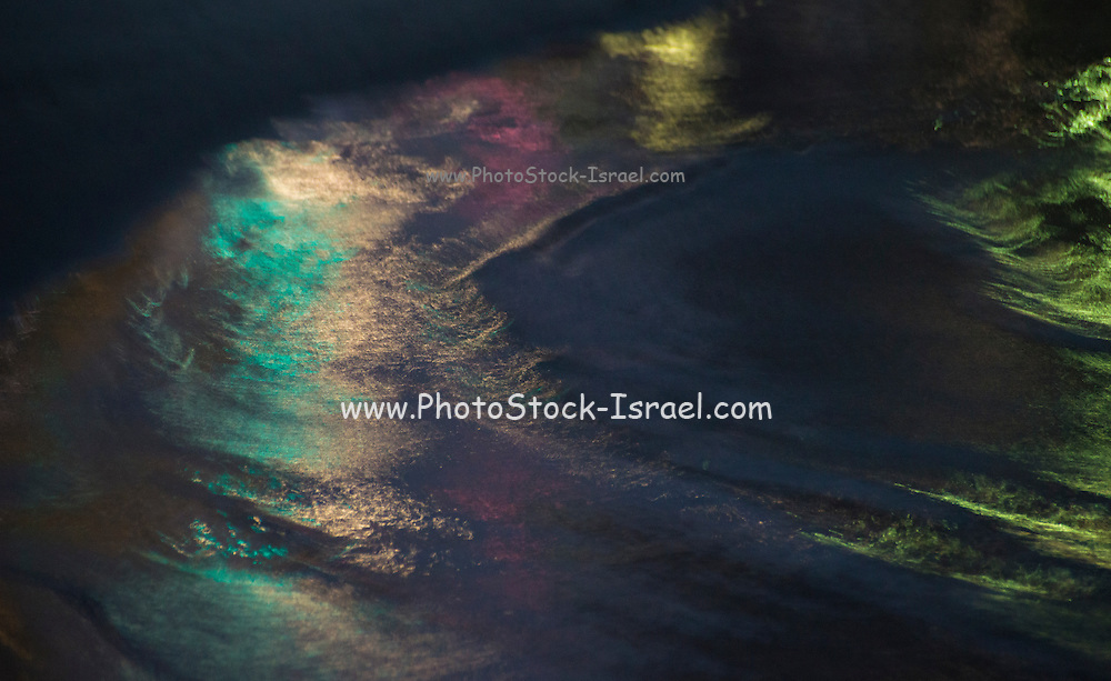 Abstract colour light in a dark black night reflecting in the waves