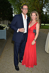MAX & JULIA KONIG at a dinner hosted by Cartier in celebration of The Chelsea Flower Show held at The Hurligham Club, London on 19th May 2014.