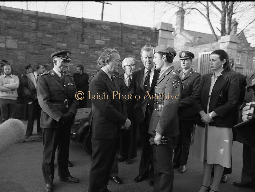 Body of Private Stephen Griffin killed in Lebanon is returned to his home soil..1980-04-19.19th April 1980.19-04-1980.04-19-80..Photographed at Arbor Hill:..An Taoiseach Charles Haughey TD in conversation with Captain Tom Rigney, Unifil, who accompanied the body of the dead soldier back from the Lebanon, Padraig Faughner TD, Minister of Defence stands between them. Maire Geoghegan Quinn TD looks on.