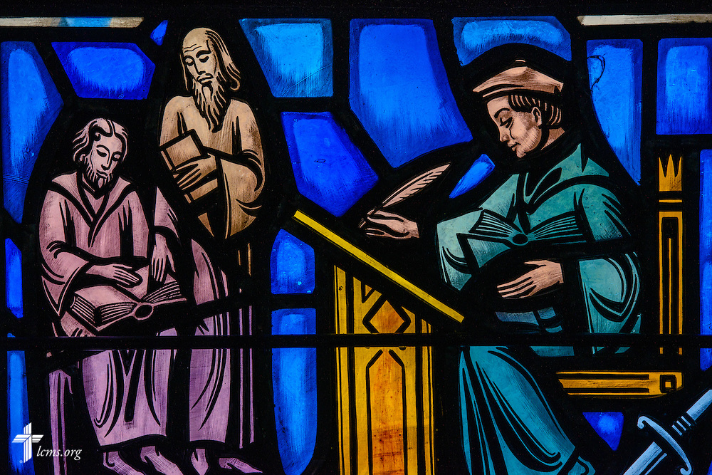 Stained glass at Luther Memorial Chapel depicts Martin Luther translating the Bible, 1521-1534, on Friday, Jan. 29, 2016, in Shorewood, Wis. LCMS Communications/Erik M. Lunsford