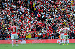 Arsenal fans celebrate after Arsenal's Aaron Ramsey scores - Photo mandatory by-line: Dougie Allward/JMP - Mobile: 07966 386802 10/08/2014 - SPORT - FOOTBALL - London - Wembley Stadium - Arsenal v Manchester City - FA Community Shield