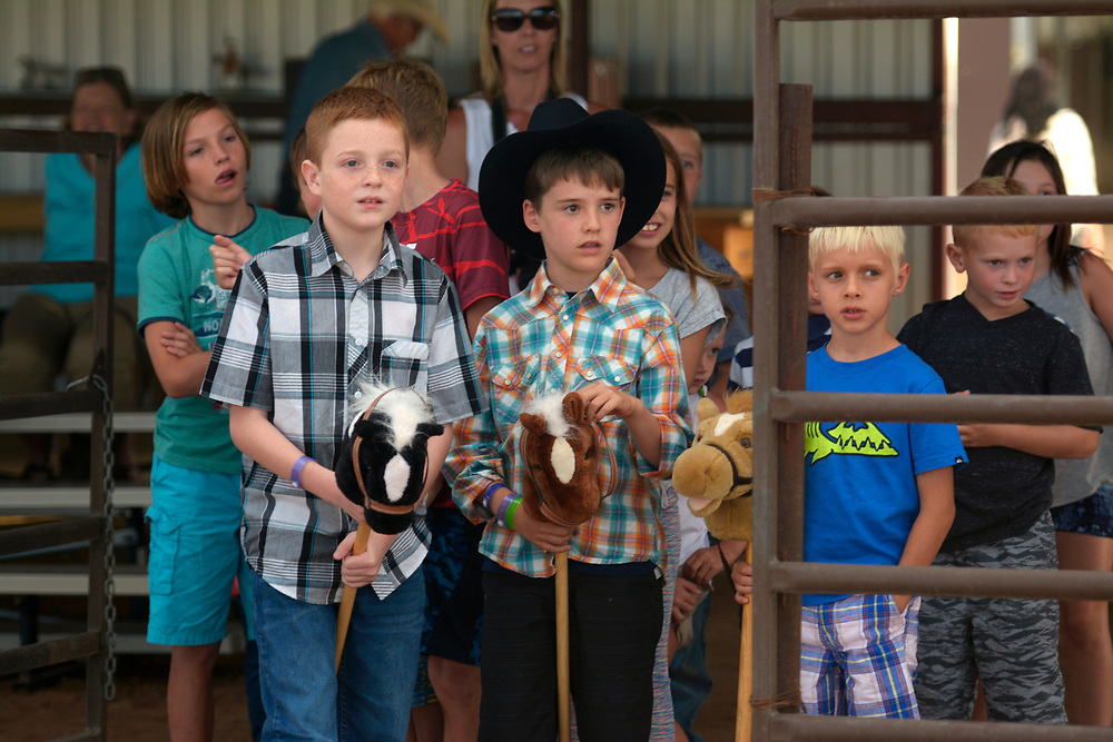 gbs072017n/RIO-WEST  -- Children line up to run the barrel race with a stick horses including Rylan Partin, 10 of Ft. Worth, Texas, left, and Spencer Lenk, 8, of Toronto, Canada during the Summer Rodeo Series at the Stables at Tamaya on Thursday, July 20, 2017.(Greg Sorber/Albuquerque Journal)